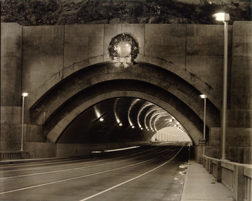 A black and white photo of the first holiday wreath placed above the Yerba Buena Tunnel.